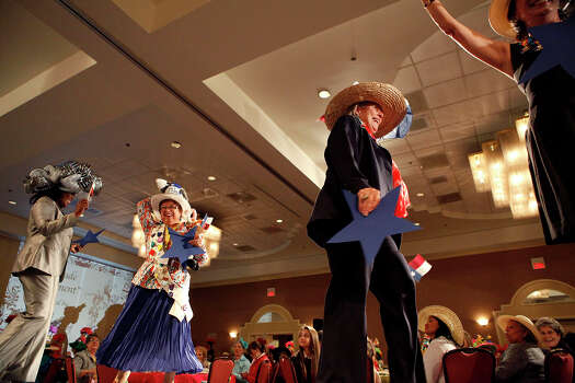 A large group hat entry with the theme Don't Mess With Texas takes the runway during The Woman's Club of San Antonio's Fiesta Hat Contest, Luncheon and Fashion Show April 16, 2014 at the Omni San Antonio Hotel at the Colonnade. There were several categories that hats were judged on including vintage, small group, most beautiful and others. Photo: Cynthia Esparza, For The San Antonio Express-News / For the San Antonio Express-News