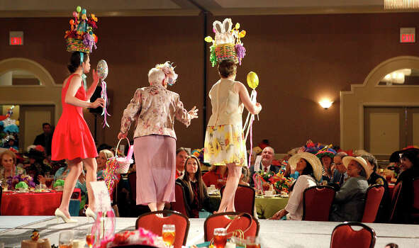 Madi Moad-Hageman (left), Elizabeth Moad, and Michelle Moad-Hageman, three generations of women stop in front of the judges table   April 16, 2014 as they participate in The Woman's Club of San Antonio  Fiesta Hat Contest, Luncheon and Fashion Show  at the Omni San Antonio Hotel at the Colonnade. There were several categories that hats were judged on including vintage, group, most beautiful and others. The hat contest has been going on since 1991. Photo: Cynthia Esparza, For The San Antonio Express-News / For the San Antonio Express-News