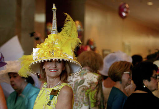 Kerry Salatino with The Woman's Club of San Antonio takes pictures of other people's hats before the Fiesta Hat Contest, Luncheon and Fashion Show April 16, 2014 at the Omni San Antonio Hotel at the Colonnade. Salatino is from Dallas but flies in for this event every year because she says it is so much fun and a great event. Photo: Cynthia Esparza, For The San Antonio Express-News / For the San Antonio Express-News