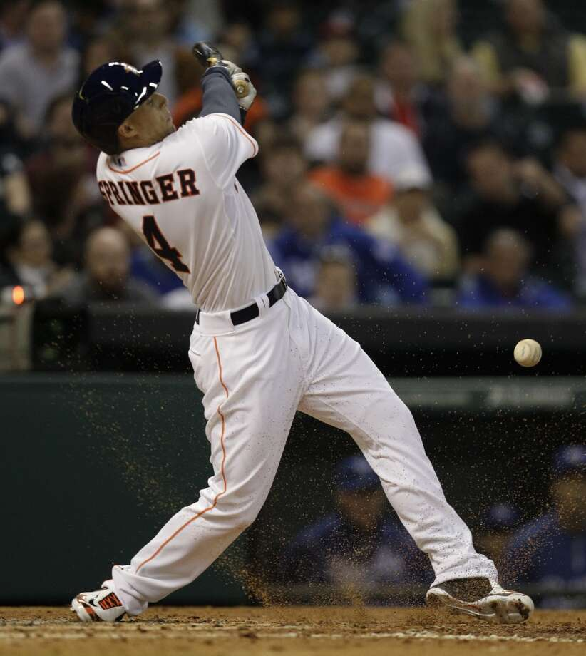 George Springer hits a single. Photo: Melissa Phillip, Houston Chronicle