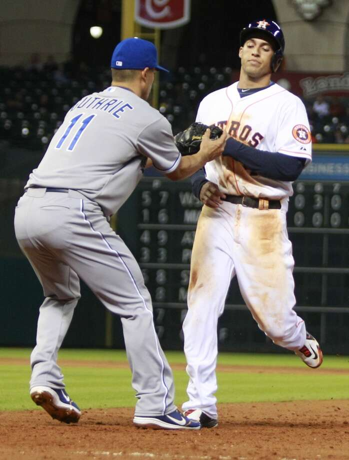 George Springer is picked off first base. Photo: Melissa Phillip, Houston Chronicle
