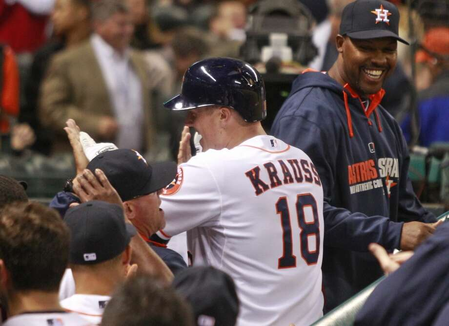 Astros manager Bo Porter, right, is all smiles as Marc Krauss celebrates his two-run home run. Photo: Melissa Phillip, Houston Chronicle