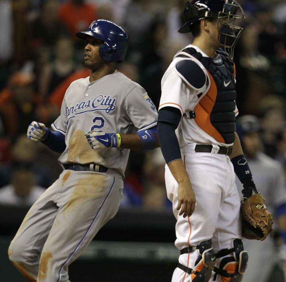 Alcides Escobar crosses the plate behind Astros catcher Jason Castro. Photo: Melissa Phillip, Houston Chronicle