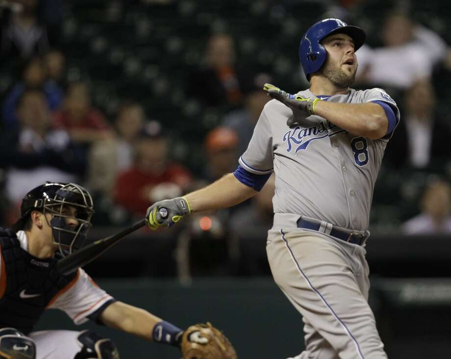 Mike Moustakas watches his home run. Photo: Melissa Phillip, Houston Chronicle