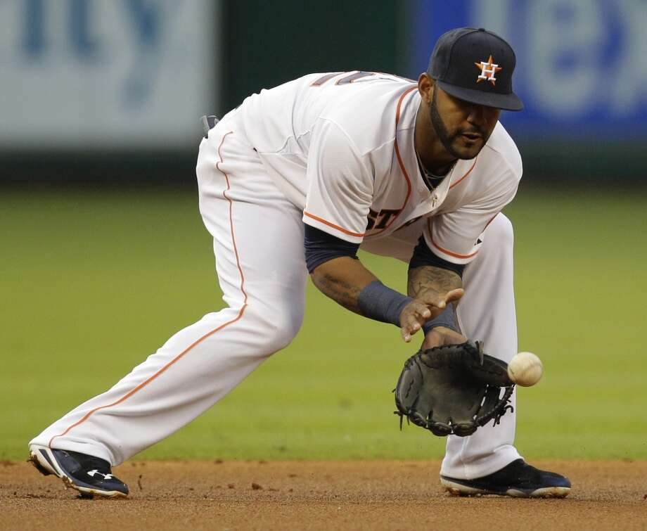 Astros shortstop Jonathan Villar fields a grounder hit by Billy Butler. Photo: Melissa Phillip, Houston Chronicle