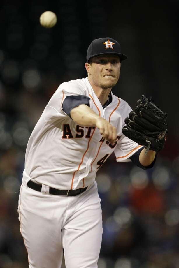 Lucas Harrell throws over to keep Nori Aoki on first base. Photo: Melissa Phillip, Houston Chronicle