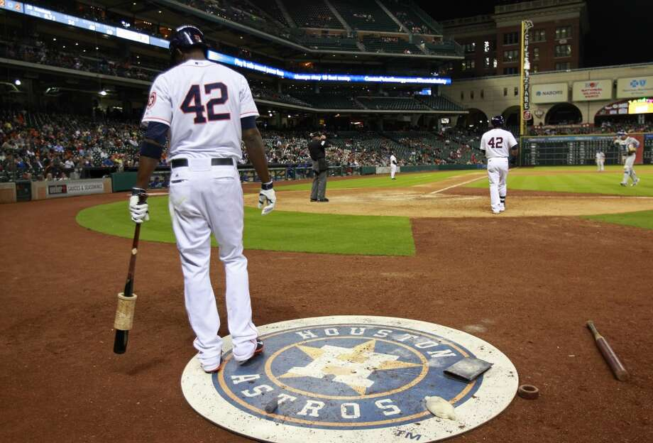 Dexter Flower waits for his at-bat. Photo: Melissa Phillip, Houston Chronicle