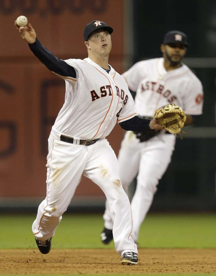 Astros third baseman Matt Dominguez throws to first base on a ground out by Lorenzo Cain. Photo: Melissa Phillip, Houston Chronicle