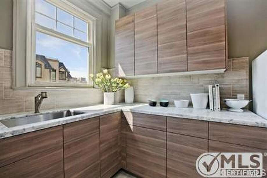 The recently renovated kitchen has marble countertops. Photo: MLS