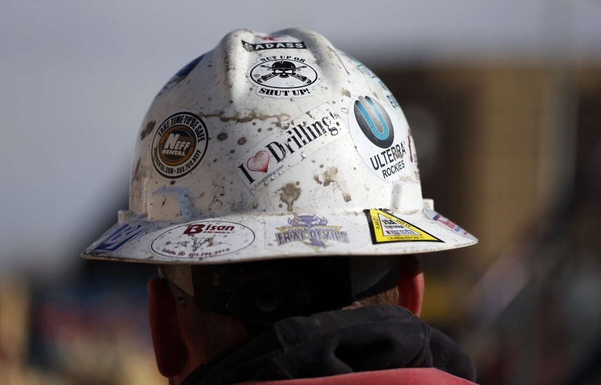 A worker wears a protective helmet decorated with stickers during a hydraulic fracturing operation at a gas well, near Mead, Colo. The first experimental use of hydraulic fracturing was in 1947, and more than 1 million U.S. oil and gas wells have been fracked since, according to the American Petroleum Institute. The National Petroleum Council estimates that up to 80 percent of natural gas wells drilled in the next decade will require hydraulic fracturing.