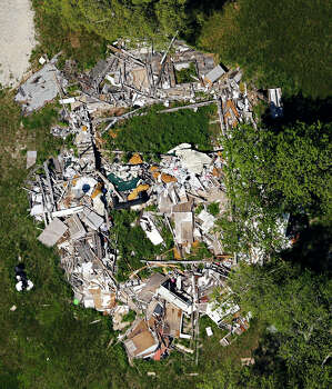 In this April 15, 2014 aerial photograph is a property that was damaged by the West, Texas, Fertilizer Company explosion one year earlier. On April 17, 2013, a fire at the plant triggered an ammonium nitrate explosion that killed 15 people and injured hundreds. (AP Photo/The Dallas Morning News, G.J. McCarthy) Photo: G.J. McCarthy, Various (SCC) / The Dallas Morning News