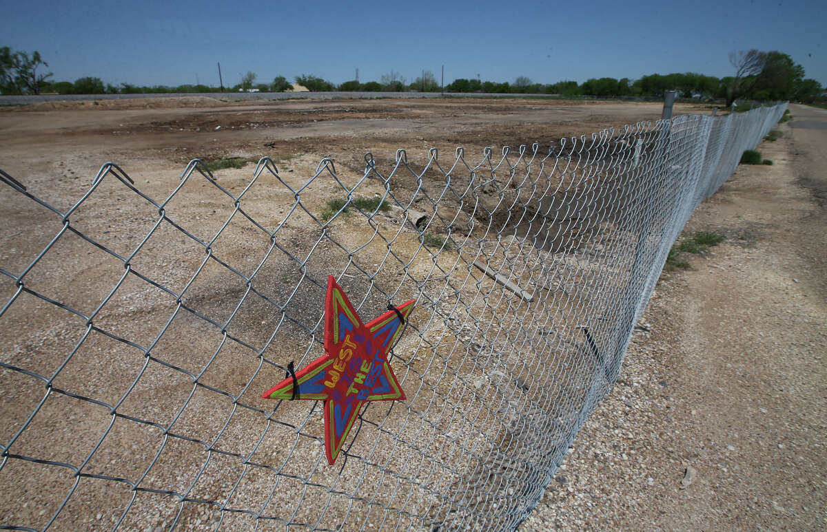 In this April 15, 2014 photo is a fence surrounding the barren site of the West, Texas, Fertilizer Company that was destroyed by an explosion one year earlier. On April 17, 2013, a fire at the plant caused a blast that caved in walls at nearby schools and homes, and sent debris flying for miles. (AP Photo/Waco Tribune Herald, Rod Aydelotte)