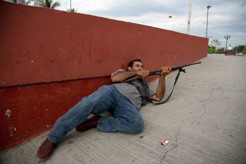 Armed Mexican citizens say they are liberating territory in what they call Tierra Caliente and are aiming for the farming hub of Apatzingan, said to be the cartel's central command.