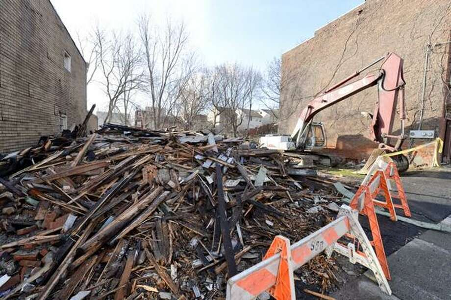 84 Elizabeth St. in Albany was just rubble Thursday morning after a  devastating fire the previous night. A demolition crew completed the demolition of the building on Thursday. (Skip Dickstein / Times Union)