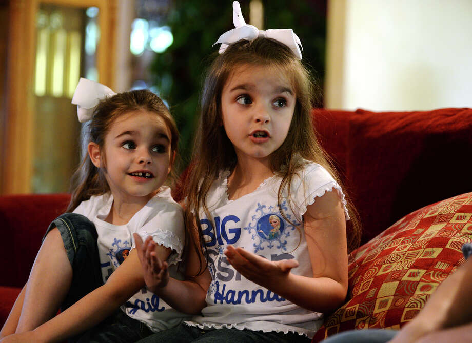 "Sisters Abigail, 4, and Hannah DeHart, 6, talk about their love of Disney's ""Frozen"" on Wednesday afternoon. Catherine DeHart is organizing a ""Frozen""-themed birthday party for her daughters, whose birthdays are only days apart. Finding related materials for the party has been a struggle as goods related to the highest-grossing animated film of all time are currently a rare commodity. Photo taken Wednesday, 4/16/14 Jake Daniels/@JakeD_in_SETX Photo: Jake Daniels / ©2014 The Beaumont Enterprise/Jake Daniels"