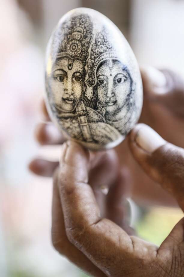 Wayan Sadra shows his exclusive painted eggs at his workshop in Sukawati, Gianyar, Bali, Indonesia.  50-year-old Wayan Sadra got the idea to start his eggshell painting business, after his niece who worked in a five star hotel asked for his help to paint on an egg for an Easter egg competition. Now the business he started in 1997 attracts customers for his painted eggs from Germany, France, Italy, and the Netherlands. Sadra usually experiences a surge in sales ahead of Easter. Photo: Putu Sayoga, Getty Images