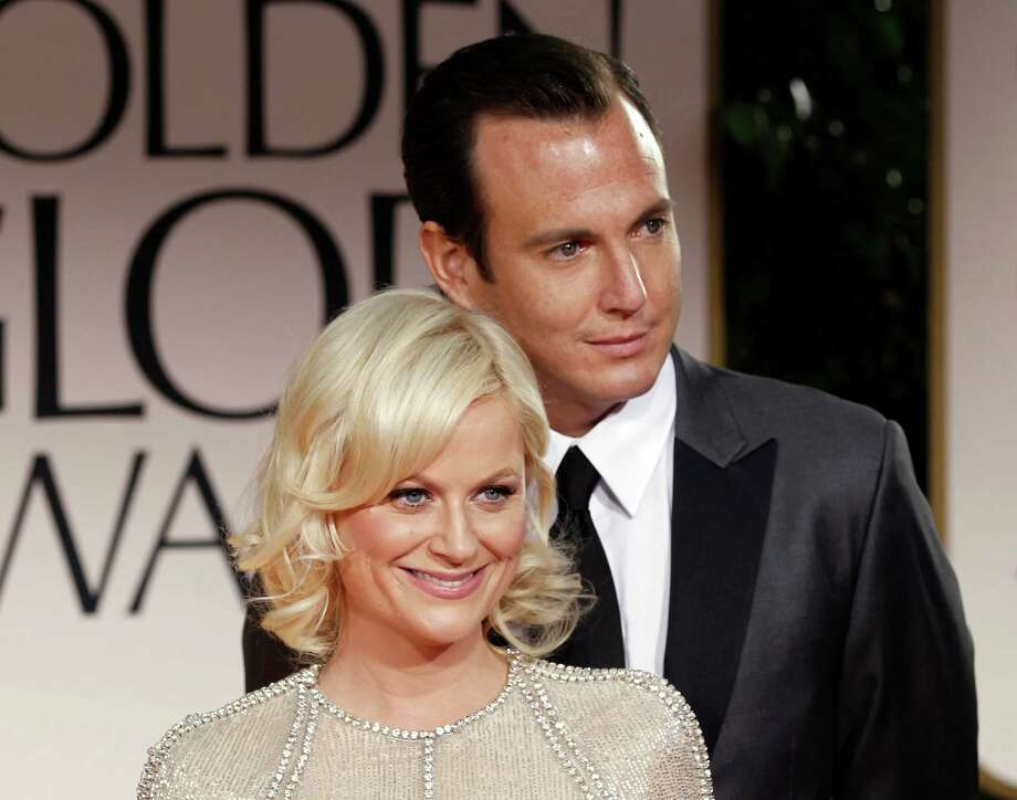 FILE - This Jan. 15, 2012 file photo shows actors Amy Poehler, left, and Will Arnett arriving at the 69th Annual Golden Globe Awards in Los Angeles. Arnett filed for divorce from Poehler on April 8, 2014, in Los Angeles Superior Court more than 18 months after the pair announced they were separating and ending their nine-year marriage.See these other celebrity couples who have split in recent years. Photo: Matt Sayles, AP / AP