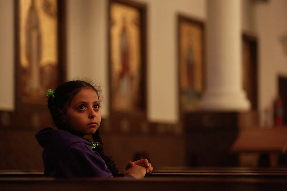 Tina Hanna, 6, attends Evening Pascha for Holy Week at St. Antony The Great Coptic Orthodox Church in San Antonio on Tuesday, April 15, 2014. Photo: Lisa Krantz, SAN ANTONIO EXPRESS-NEWS / SAN ANTONIO EXPRESS-NEWS