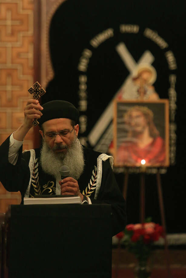 Father Makary Ibrahim concludes Evening Pashca for the night during Holy Week at St. Antony The Great Coptic Orthodox Church in San Antonio on Tuesday, April 15, 2014. Photo: Lisa Krantz, SAN ANTONIO EXPRESS-NEWS / SAN ANTONIO EXPRESS-NEWS