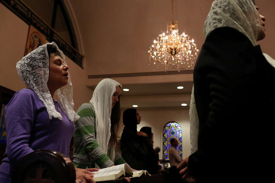 Mona Kaldas, left, participates in Evening Pascha for Holy Week at St. Antony The Great Coptic Orthodox Church in San Antonio on Tuesday, April 15, 2014. Photo: Lisa Krantz, SAN ANTONIO EXPRESS-NEWS / SAN ANTONIO EXPRESS-NEWS