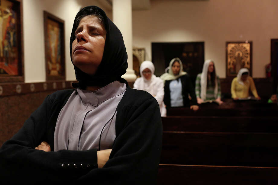 Sister Veronica prays during Evening Pascha for Holy Week at St. Antony The Great Coptic Orthodox Church in San Antonio on Tuesday, April 15, 2014. Photo: Lisa Krantz, SAN ANTONIO EXPRESS-NEWS / SAN ANTONIO EXPRESS-NEWS