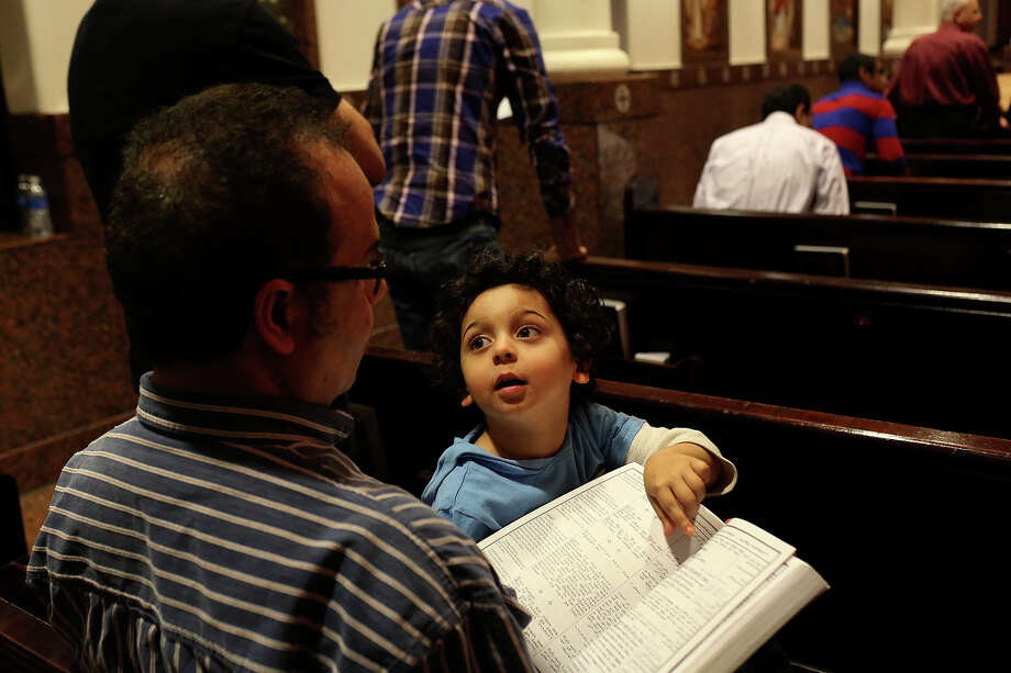 Ezzat Lamaie participates in Evening Pascha with his son, Joshua Lamaie, 3, at St. Antony The Great Coptic Orthodox Church in San Antonio on Tuesday, April 15, 2014. Photo: Lisa Krantz, SAN ANTONIO EXPRESS-NEWS / SAN ANTONIO EXPRESS-NEWS