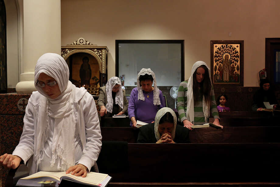 Parishioners pray during Evening Pascha for Holy Week at St. Antony The Great Coptic Orthodox Church in San Antonio on Tuesday, April 15, 2014. Photo: Lisa Krantz, SAN ANTONIO EXPRESS-NEWS / SAN ANTONIO EXPRESS-NEWS