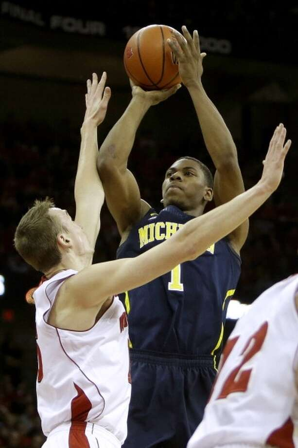 Glen Robinson III  Position: Forward  Ht./Wt: 6-6/220 lbs  School: Michigan  Classification: Sophomore  2013-14 stats: 14 points, four rebounds, 1 assist, 1 steal per game Photo: Mike McGinnis, Getty Images
