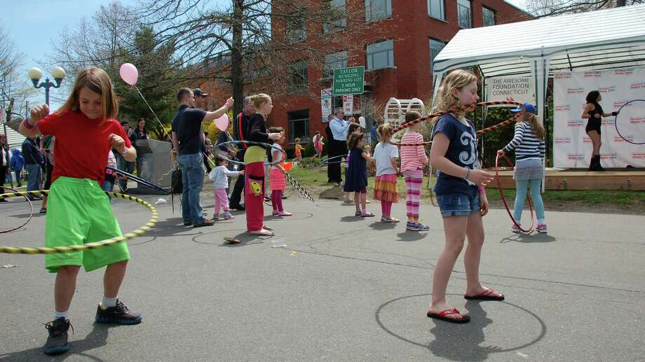 Young people take to their hula hoops during a demonstration at the 2013 Westport Mini Maker Faire. The event returns this year to the Westport Library on Saturday. Find out more. Photo: File Photo, Jarret Liotta / Westport News contributed