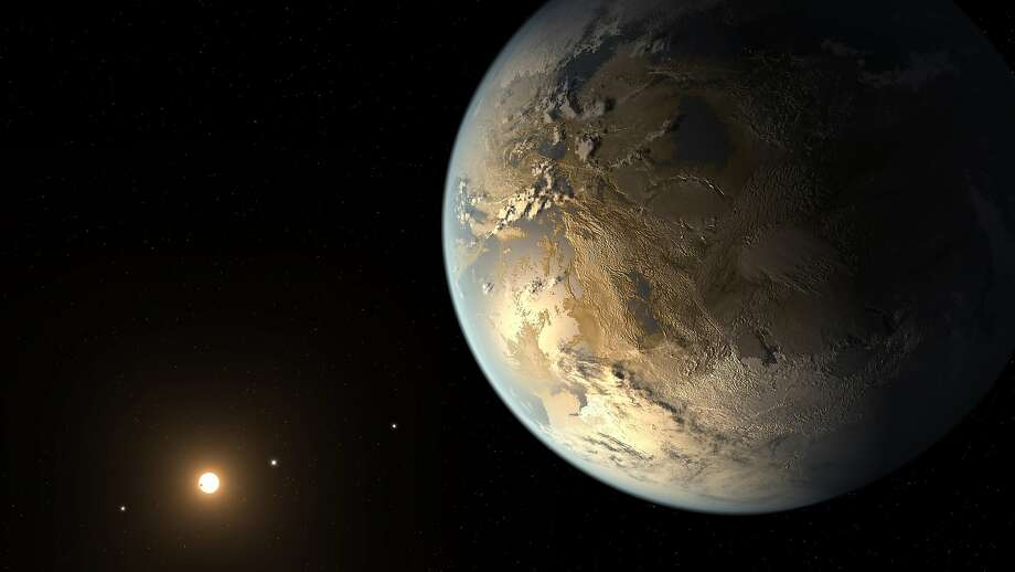 This artist's rendering provided by NASA on Thursday, April 17, 2014 shows an Earth-sized planet dubbed Kepler-186f orbiting a star 500 light-years from Earth. Astronomers say the planet may hold water on its surface and is the best candidate yet of a habitable planet in the ongoing search for an Earth twin. Photo: T. Pyle, Associated Press