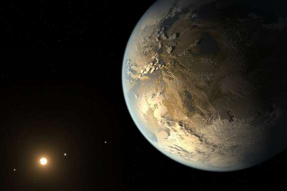 This artist's rendering provided by NASA on Thursday, April 17, 2014 shows an Earth-sized planet dubbed Kepler-186f orbiting a star 500 light-years from Earth. Astronomers say the planet may hold water on its surface and is the best candidate yet of a habitable planet in the ongoing search for an Earth twin.