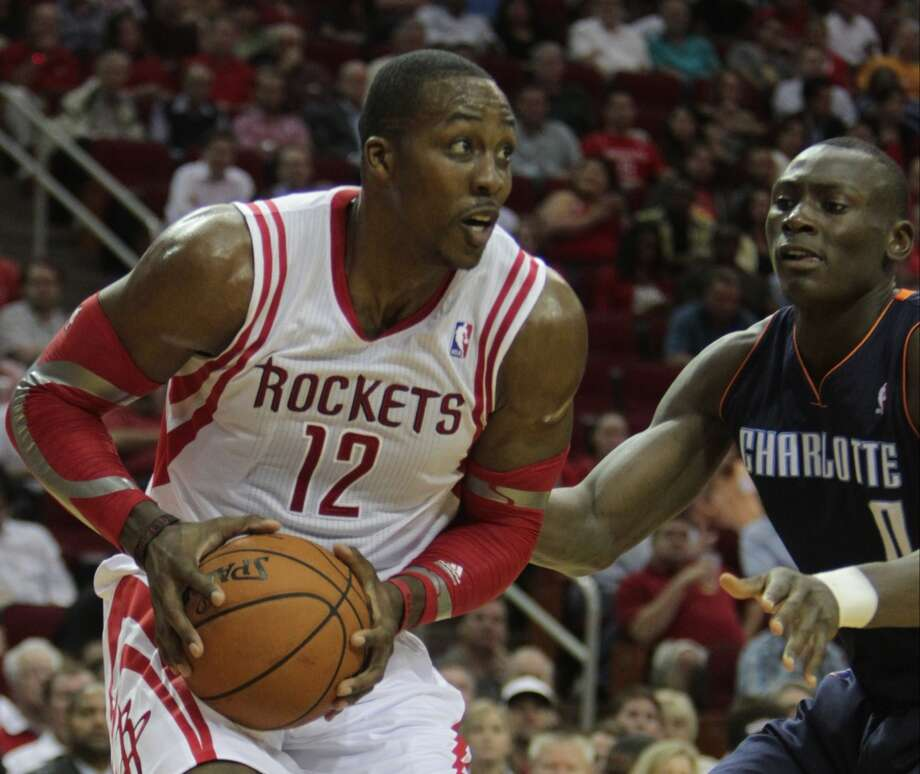 """The season opener, Oct. 30  The much anticipated debut of the new Rockets wasn't a dominant performance as they defeated the Charlotte Bobcats 96-83. It was, however, a taste of what center Dwight Howard would bring to the table as he had 17 points and 26 rebounds. Coach Kevin McHale stuck with his """"big"""" experiment and started Howard at power forward and Omer Asik at center. The two combined for 40 rebounds - more than the entire Bobcats' roster (37). Photo: James Nielsen, Houston Chronicle"""