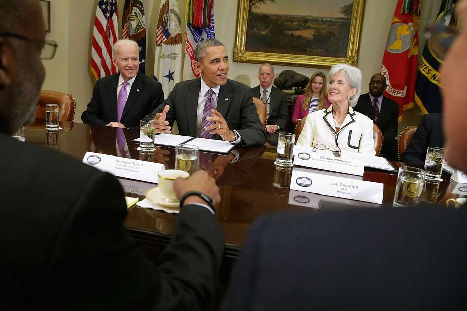 Vice President Joe Biden (left), President Obama and outgoing health chief Kathleen Sebelius confer. Photo: Chip Somodevilla, Getty Images