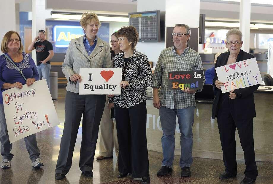 Oklahomans for Equality members rally for plaintiffs Wednesday at Tulsa International Airport. Photo: Brandi Simons, Associated Press