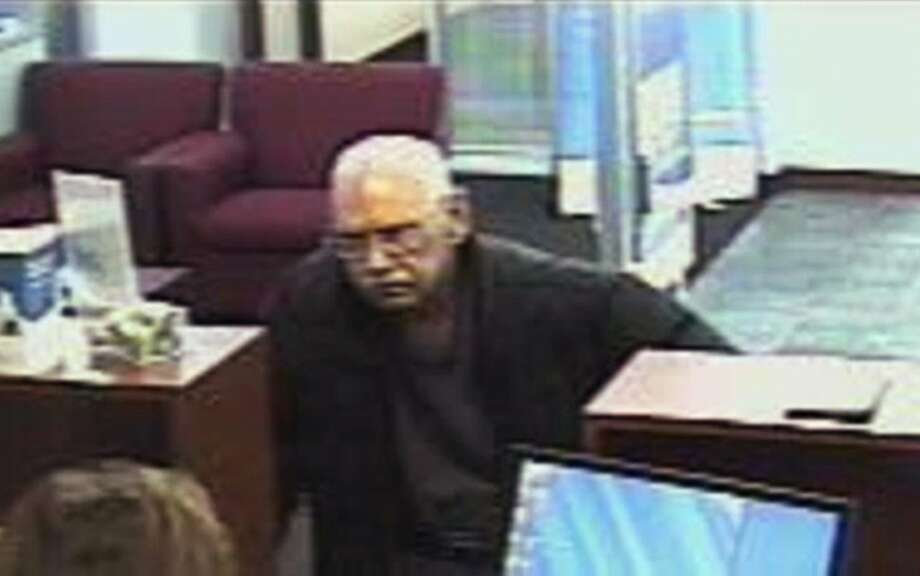 FILE - This Feb. 9, 2013 file surveillance photo provided by the FBI shows 73-year-old Walter Unbehaun, an ex-convict from Rock Hill., S.C., during a bank robbery in Niles, Ill. Unbehaun allegedly told investigators he intended to get caught so he could live his final years behind bars. On Thursday, April 17, 2014, Unbehaun is scheduled to be sentenced in Chicago. In 50 years, he has spent just six out from behind bars. His case highlights a wider societal dilemma about what to do with an increasingly elderly ex-cons, many of whom spent so much of their lives inside prison that they, like Unbehaun, can't cope with life on the outside. (AP Photo/FBI, File) Photo: Associated Press