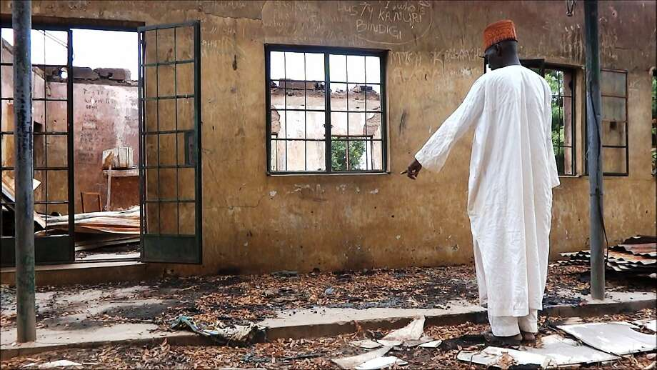 An employee inspects a student hostel in Yobe state after militants killed 41 students last year. Photo: Aminu Abubakar, AFP/Getty Images