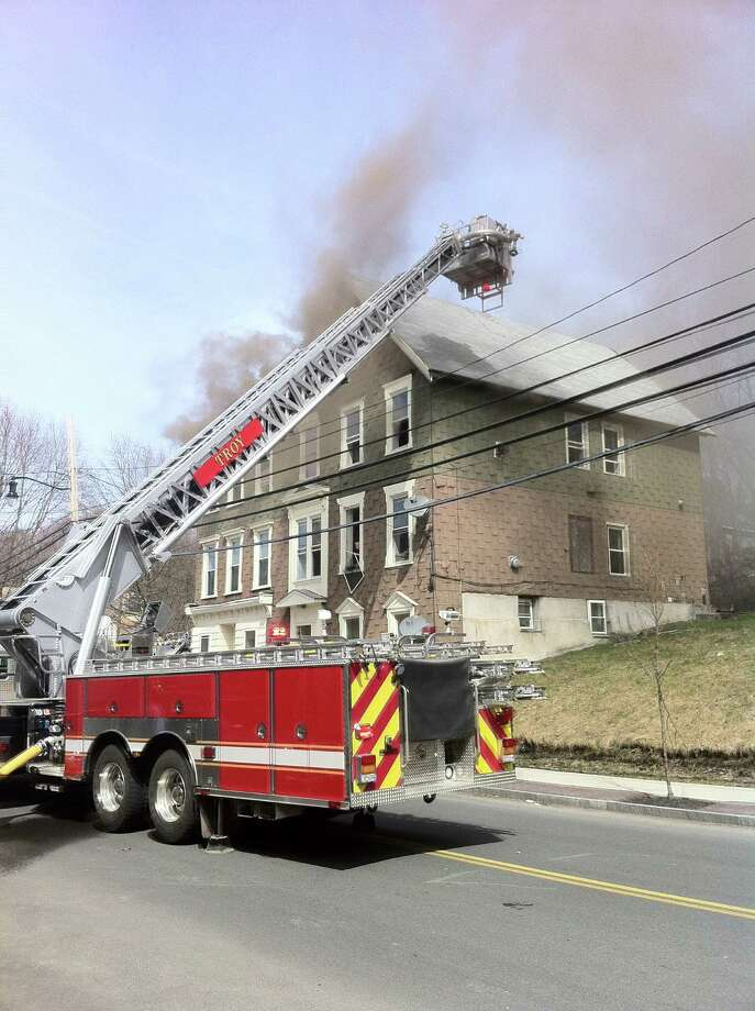 Firefighters respond to a blaze at 554 Fourth St., Troy, N.Y. on Thursday, April 17, 2014.  (Kenneth C. Crowe II)