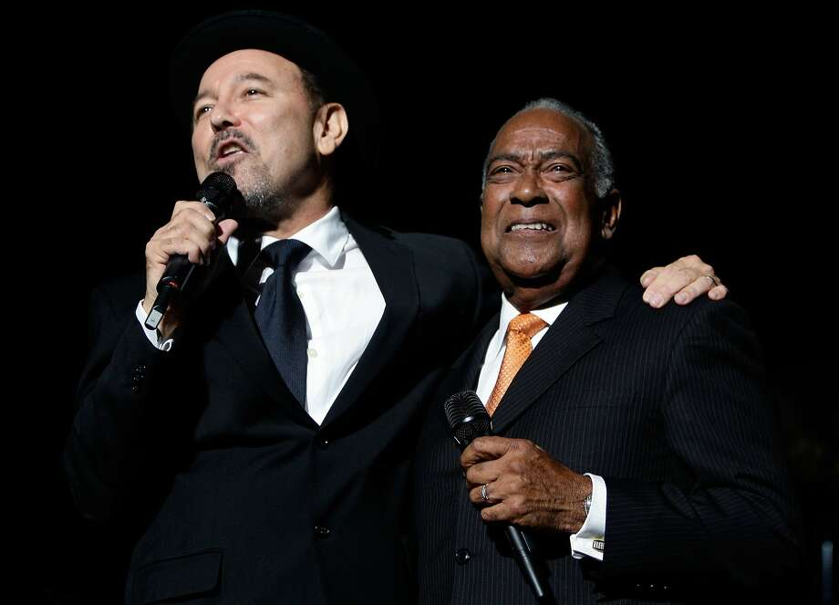 Cheo Feliciano (right, with singer Rubén Blades in 2009) was killed in Puerto Rico when his Jaguar hit a light post in the predawn hours Thursday. Photo: Andres Leighton, Associated Press