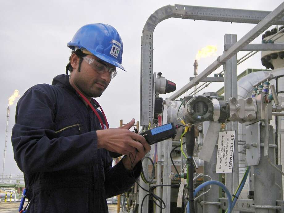 18. Kazakhstan  Foreign workers: 2014 -- $117,000 2013 -- N/A  Local workers: 2014 -- $38,900 2013 -- N/A  [Photo: An oil worker takes measurements on the Tengizchevroil  oil and gas processing plant at Tengiz oil field in western Kazakhstan September 11, 2006.] Photo: STAFF, REUTERS