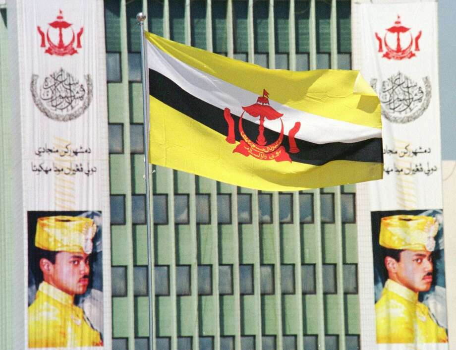 16. Brunei  Foreign workers: 2014 -- $119,400 2013 -- N/A  Local workers: 2014 -- $99,300 2013 -- N/A  [Photo: A Brunei flag flies with the portraits of Prince Al-Muhtadee Billah in the background in preparation of the proclamation ceremony of his Royal Highness the Crown Prince in Bandar Seri Begawan, Sunday Aug. 9, 1998 in Brunei.] Photo: VINCENT THIAN, AP