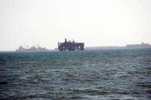 9. Ghana  Foreign workers: 2014 -- $128,500 2013 -- N/A  Local workers: 2014 -- $26,800 2013 -- N/A  [Photo: An oil rig works in Sekondi waters, Ghana.]