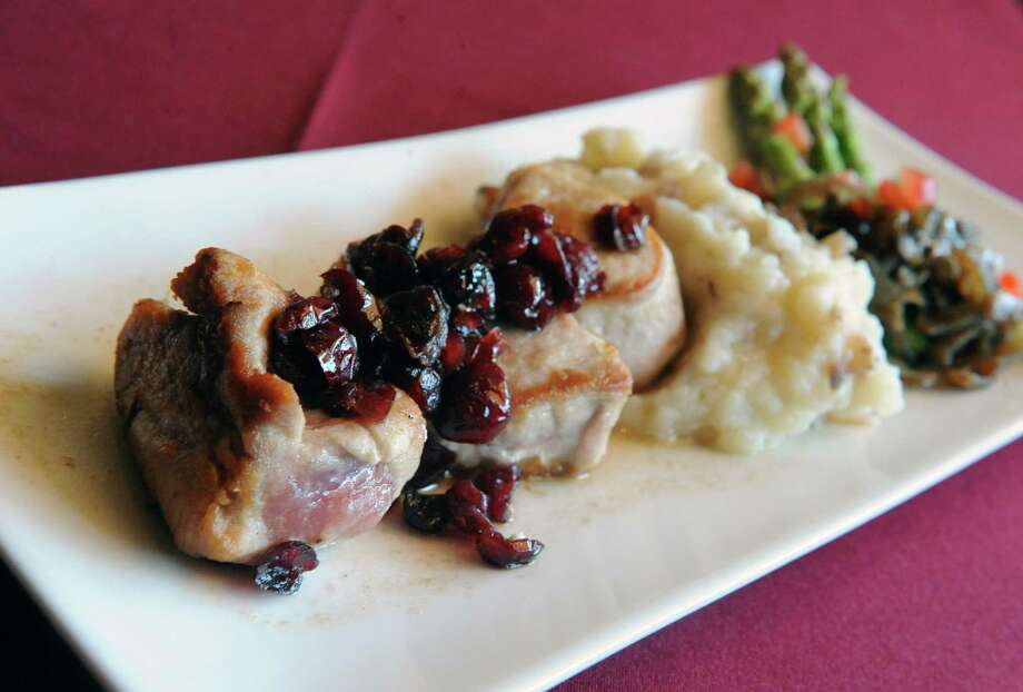 Restaurant at 62 Beekman, 62 Beekman St., Saratoga Springs, NY, 518-584-1022. Visit Web site. Read our review. Pan seared pork tenderloin medallions at Restaurant at 62 Beekman on Wednesday April 9, 2014 in Saratoga Springs, N.Y. (Michael P. Farrell/Times Union) Photo: Michael P. Farrell / 00026397A