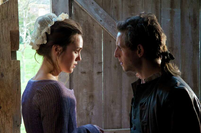 This image released by AMC shows Heather Lind as Anna Strong, left, and Jamie Bell as Abe Woodhull in a scene from