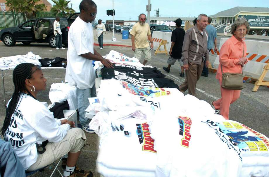 """Vendors, Ed Kittrell, top right, and Cathy Jordan, bottom right, wait for costumers during Beach Party on  Sunday, April 17, 2005, in Galveston.  Jordan and Kittrell said not only are the crowds down but they also faced harassment from the City of Galveston.   """"An individual from the city tried to confiscate our merchandise even after we showed him our permit,"""" said Jordan as Kittrell agreed. Photo: Carlos Javier Sanchez, For The Chronicle / Freelance"""
