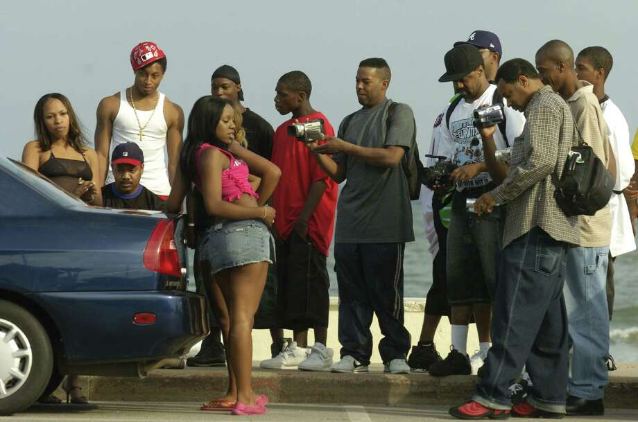Men gawk as they video tape and photograph women during the start of Beach Party  in Galveston on Friday, April 15, 2005. Photo: Carlos Javier Sanchez, For The Chronicle / Freelance