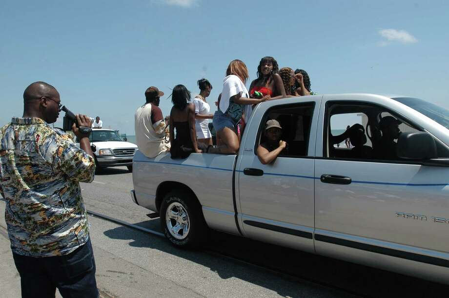 Samuel Smith videotapes women on Seawall Boulevard during Beach Party in Galveston on  Saturday, April 16, 2005.   Carlos Javier Sanchez : For The Chronicle Photo: Carlos Javier Sanchez, For The Chronicle / Freelance