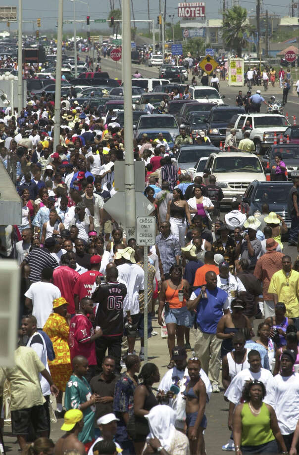 Thousands of people flocked to the Galveston's seawall to be a part of Beach Party Saturday,  April 21, 2001 in Galveston. Galveston officials say there could be 200,000 visitors on the island to participate in the festivities. Photo: CHRISTOBAL PEREZ, HOUSTON CHRONICLE / HOUSTON CHRONICLE