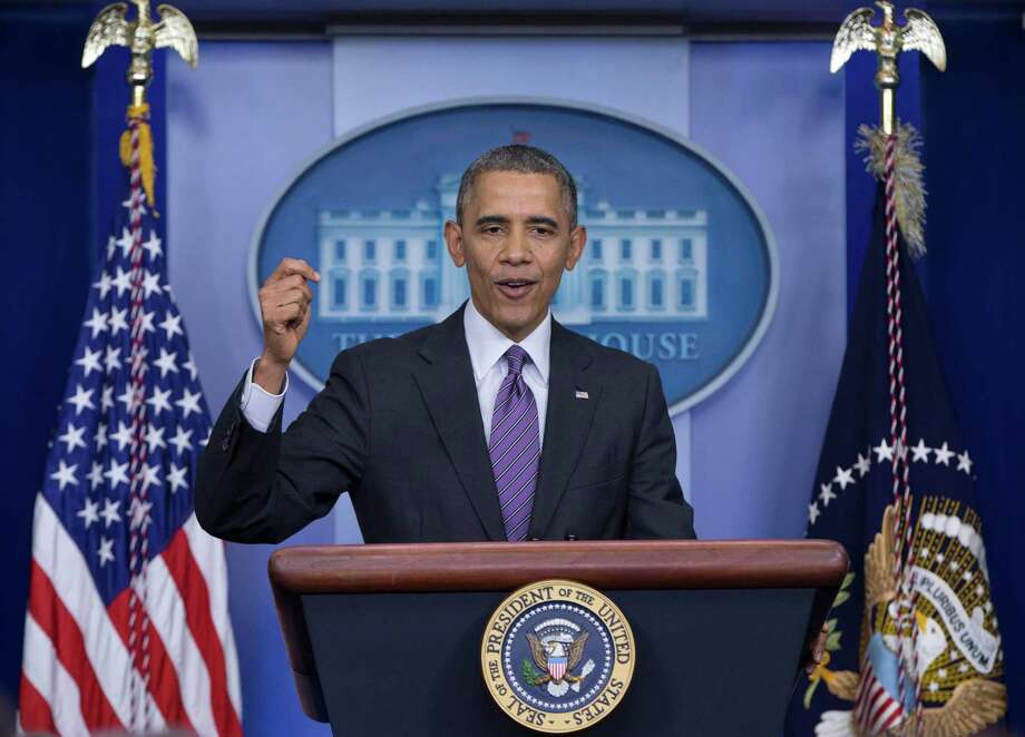 President Barack Obama speaks about health care, Thursday, April 17, 2014, in the briefing room of the White House in Washington. The president said eight million have signed up for health insurance under Affordable Care Act. Photo: Carolyn Kaster, AP / AP