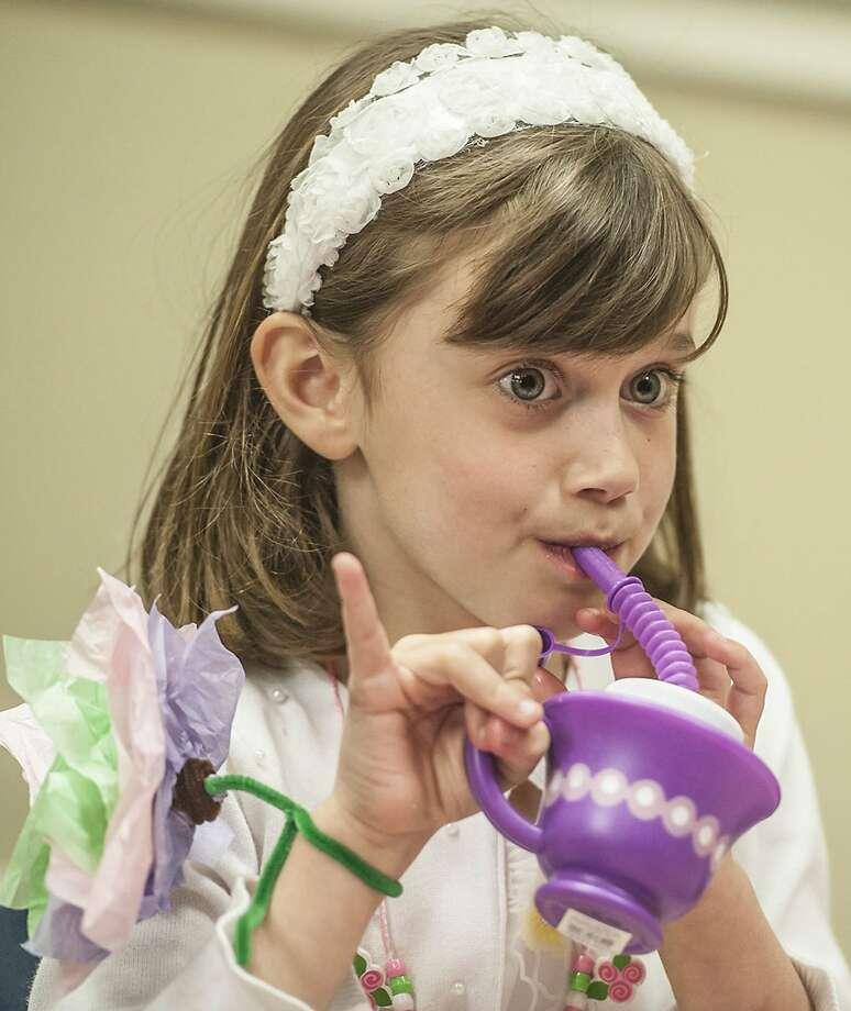 Don't bogart that 'tea' hookah, Lexi:Six-year-old Lexi Reynolds attends a Fancy Nancy Tea 