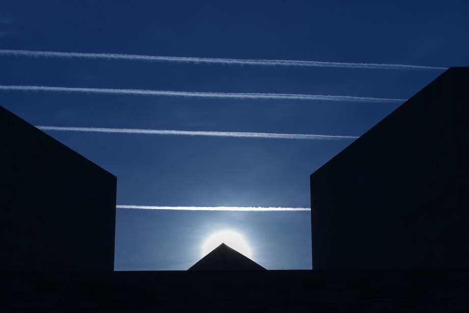 Vapor trails: Contrails from jet planes intersect the National Museum of Art in Washington. Photo: J. Scott Applewhite, Associated Press